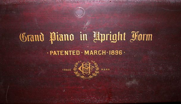 restored upright piano closed