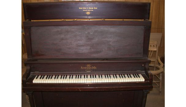 closed upright piano